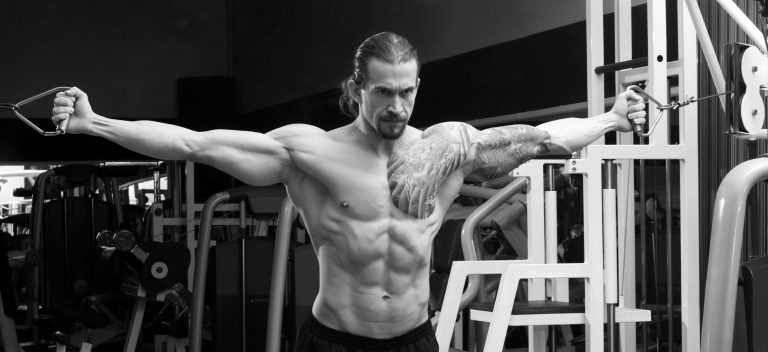 muscular man (20s) exercising in the gym
